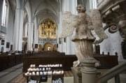 Berlin- A winged marble angel and candles St Marienkirche - 2734
